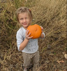 Olivia and a pumpkin